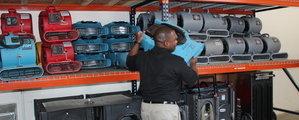 Water Damage Clute expert preparing equipment for job